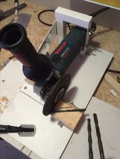 Turn an angle grinder into a bench grinder, along with a jig for sharpening drill bits.