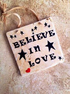 A personal favorite from my Etsy shop https://www.etsy.com/listing/262659335/rustic-wall-sign-believe-in-love-sign