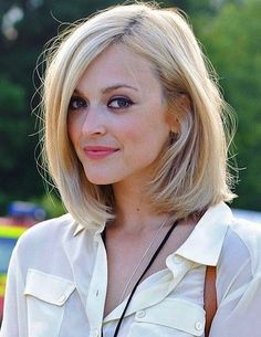 Short Bob Hairstyle - Blonde Bob Haircut with Side part of shorter hair.