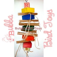 This is a great bird toy with pine wood, dragon wood, Lots of leather & Abc blocks