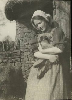 Why is she holding the lamb like that? Makes me think of Charlotte's Web, sheep-style. Sheep Art, Sheep Wool, Photo Writing Prompts, Animals Beautiful, Beautiful People, Vintage Pictures, Cute Baby Animals, Old Photos, Creatures