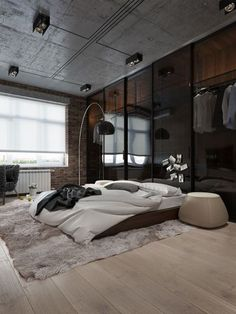 Urban bedroom design in grey with beautiful wall lamp