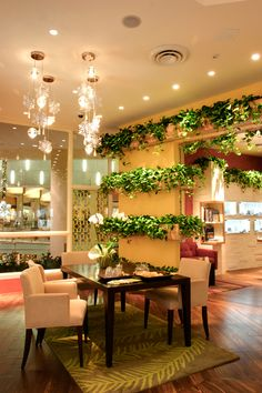 Indoor plant boxes make this room look like a million bucks, for much less.