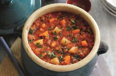 Slimming World's tomato, lentil and vegetable soup recipe makes a filling chunky soup made with curry spices and ginger - perfect as a warming lunch. This mouth-watering soup is made in just 30 mins making it a quick and easy option when you're short on time.
