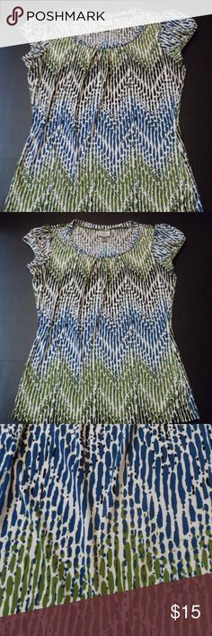 """Women's Top Shirt Career Casual Worthington Small Women's Cap Sleeved multicolored Stretch Top/Shirt/Blouse from Worthington, size S Abstract striped Pattern in black, green and blue 95% polyester & 5% Spandex Elastic @ sleeves Scoop neckline  Approx. 23.25"""" long from shoulder seam  Approx. 17"""" wide at the chest, unstretched, from underarm to underarm. Item is in GUC;   I do not find any stains, rips or odors.  From smoke free home I have 100% positive feedback on my other selling channel…"""