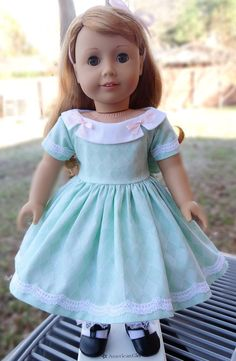 This dress has been made to fit 18 dolls like American Girl, Madame Alexander and more.  This sweet dress was made from a pretty mint green cotton