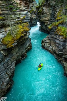 Athabasca Falls Canyon - I've never seen colors like this anywhere I've been. It was an incredible experience watching my friend kayak through this canyon and being able to document it was even better. The water color is created from a glacier run off. Everywhere we went in Alberta this was the color of the water. We could drink right from it! No complaints at all!! Hope you enjoy. Visit www.chrisburkard.com for more!