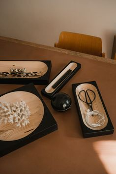 """The """"Cavetto"""" table trays were designed by Klemens Schillinger in 2020. The minimal pieces in black lacquered pine are produced by the Austrian furniture label """"One For Hundred"""". Due to the different color and grain of the wood, each """"Cavetto"""" table tray is a unique piece – not only for your home office. Available in our online shop. Home office decoration 