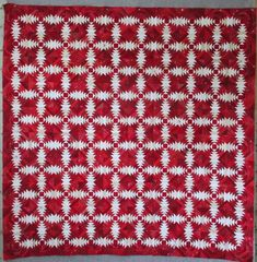 "Red and white pineapple quilt, 60 x 60"", by Cupcakes 'n Daisies.   There are 10 rows of 10 blocks for a total of 100 (6"")  blocks. It has approximately 3,700 pieces."