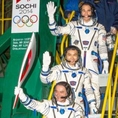 "Expedition 38 Soyuz Commander Mikhail Tyurin, holding the Olympic torch, and Flight Engineers Koichi Wakata and Rick Mastracchio wave farewell prior to boarding the Soyuz TMA-11M rocket for launch. Needless to say, the torch was not lit on the station or in space. (Credit: NASA/Bill Ingalls) Mona Evans, ""Galactic Winter Games"" http://www.bellaonline.com/articles/art182620.asp"