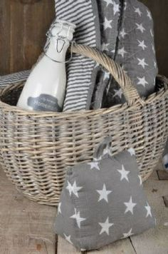 Grey and white stars in a basket. Baskets On Wall, Wicker Baskets, White Cottage, Cozy Cottage, Star Decorations, Love Your Home, Flower Girl Basket, Twinkle Twinkle Little Star, Textiles