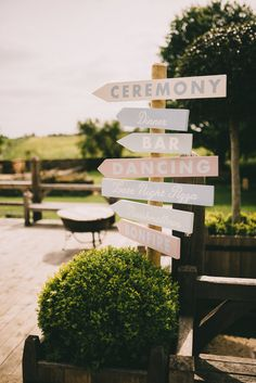 Direction Sign Post | Classic rustic wedding at Cripps Barn | White flowers including gypsophila | Image by Modern Vintage Weddings | http://www.rockmywedding.co.uk/hannah-simon/