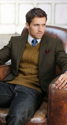Men's Tobacco V-neck Sweater, Black Jeans, Burgundy Silk Pocket Square, Olive Blazer, Navy Silk Tie, and White and Blue Gingham Dress Shirt.