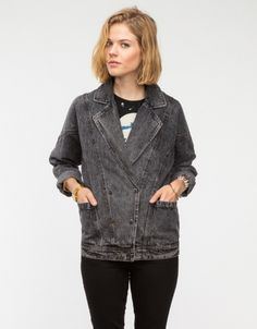 Oversized, double breasted denim jacket with front button snap closure, two front waist pockets, and notched lapels.