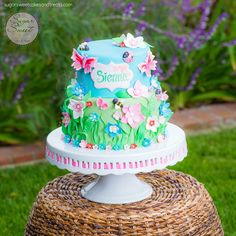 """A bright and cheerful cake made for a friend's 3 year old born on the first day of Spring.  Designed to match the """"garden girl"""" party decor.  All decorated in fondant with hand painted name plaque and fondant butterflies, bees, ladybugs and flower blossoms.  Photography by bryanramsayphotography.com"""
