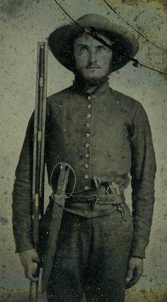 Confederate soldier William M. Hogsett of Texas with a double-barreled shotgun