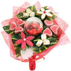 Bouquet sucré spécial amoureux, pour les valentines et valentins gourmands. Calissons, bonbons coeur, nougat et sa boule garnie de coeurs en chocolat : une création originale sur le thème de la Saint-Valentin à offrir pour le coups de cœur et à déguster en solo ou à 2,,,