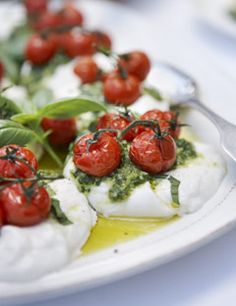 Mozza Caprese... slow-roasted vine tomatoes, creamy burrata cheese, and bright hand-pounded pesto served with a toasted very thick bread rubbed with garlic and drizzled in olive oil