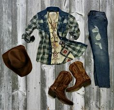 Tasha Polizzi Spring 2015 cowgirl style blue plaid 'warrior shirt' over the cool waffle knit tribal 'blanket print tee' paired with some distressed jeans, cowboy boots and cowboy hat. western casual cowgirl ranch outfit