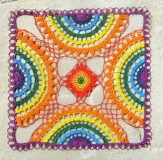 From A Japanese Crochet  book. Originally presented in white tread as a doily option, this is done up in a beautiful rainbow thread.     Mas meus olhos viram isto by Colorido Eclético - por Cristina Vasconcellos, via Flickr