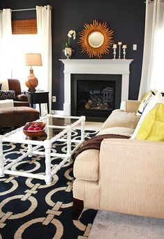 """Navy living room, Benjamin Moore """"Stunning"""", sunburst mirror"""