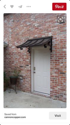 Short Height Metal Awning Over Single Doorway
