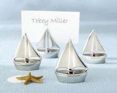 Shining Sails Silver Place Card Holders Set of 4   When the sea beckons, love sets sail near the splendor of a sun-drenched shore. Create the ambiance only a beach...