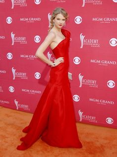 Celebrities | Taylor Swift in a beautiful red sleeveless Angel Sanchez gown