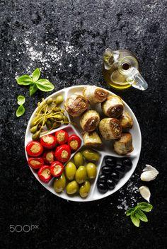 starter of green olives, black olives, capers, buffalo mozzarell - starter of…