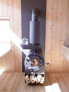 The Ufogel holiday house is an example. Heated by this sturdy boiler-style stove. Steel Framing, Stove Fireplace, Black Fireplace, Wood Fireplace, Fireplaces, Rocket Stoves, Wood Burner, Cabins And Cottages, Tiny Living