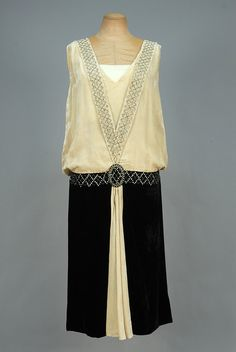 Thanks ingridhirschfel for this post.LOT 681 PANNE VELVET EVENING DRESS with RHINESTONES, - whitakerauction.Bone silk sleeveless bodice having V-shaped band with diamond lattice of prong-set rhinestones and crystal beads terminating in# 20s Fashion, Art Deco Fashion, Fashion History, Retro Fashion, Vintage Fashion, Victorian Fashion, Vintage Gowns, Mode Vintage, Vintage Hats