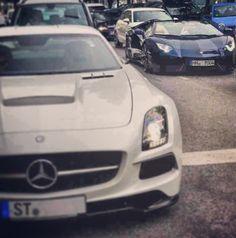 Forget the Mercedes....navy blue Lamborghini with cream seats - ooh la la! Lol