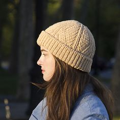Divide is a richly textured unisex beanie worked in the round, featuring an architecturally inspired allover pattern of shifting parallel columns of ribbing and diagonal cables. Details like the tubular cast-on, seamless transitions from ribbing to cables, and hidden crown decreases yield a polished finished accessory with a stylish, ready-to-wear look.