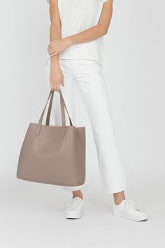 A structured version of our Classic Leather Tote made using Italian leather and microsuede lining that is bonded together to create a clean, architectural aesthetic. This double-face construction reinforces an elegant shape, finished with hand-applied edge paint and subtly contrasting lining. Selective details like interior lateral ties allow for an unexpected evolution of the silhouette when looped in a bow.