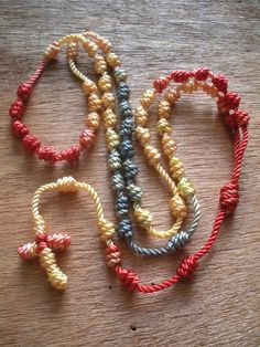 Knotted Cord Rosary  Red/Yellow/Grey Marble by Georgie Girl Originals on Etsy. $12 & FREE SHIPPING!