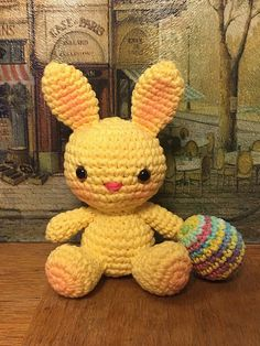 """This is a free crochet pattern for a small, sitting bunny and also includes the Easter egg pictured. The finished bunny size depends on the yarn weight and hook size you choose. The pictured bunny is approximately 5.5"""" tall and was made with Sugar n' Cream cotton yarn in the color yellow, with a 3.0mm hook. Feel free to share the pattern or sell items made with the pattern. Enjoy!"""