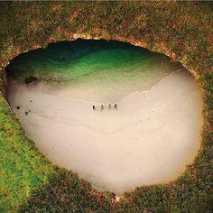 Hidden Beach in a bomb hole. Photo by  Lugo (@lugo_lugo.) #drone #drones…