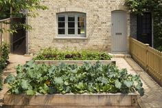 Convert car park or too much patio into garden space - the radiant heat would be a benefit in colder climates.  (Edible front yard garden in Dorset, England | Gardenista)