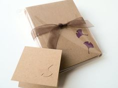 kraft card base with punched gingko leaves...like the kraft on kraft for etched look too...