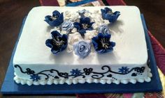 Purple and lavender rose cake. All flowers hand made. Pretty! Made by my mom. Deb's