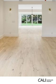 Contemporary home with natural light engineered hardwood floor. UV oil finish highlights natural knots & wood grain. Backed by a 50-year residential warranty