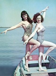 1950s, Bettie Page & friend...pre-photoshop! Check out those curvy legs. That's what real women look like!