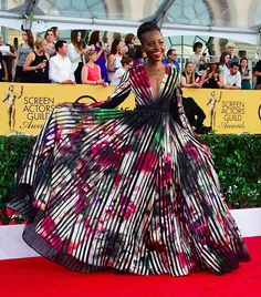 Gorgeous Lupita Nyong'o The gown makes me happy!!!! Color makes me happy!!! Everything about this makes me happy!!!