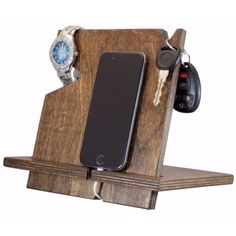 Palmetto Wood Shop offers universal wooden docking stations for sale online, compatible with all cell phones. It holds your phone, wallet, watch and keys.