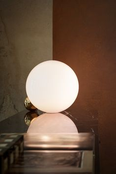 """""""Two spheres capture a perfect moment as if they just rolled on the table and simply met at that point."""" - Michael Anastassiades describes his Copycat lamp."""