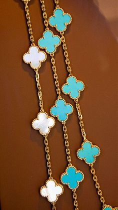 Van Cleef & Arpels Clover necklaces in Gold, Mother of Pearl & Turquoise Jewelry Accessories, Fashion Accessories, Fashion Jewelry, Women Jewelry, Jewelry Design, Jewelry Ads, Designer Jewellery, Jewelry Trends, Clover Necklace