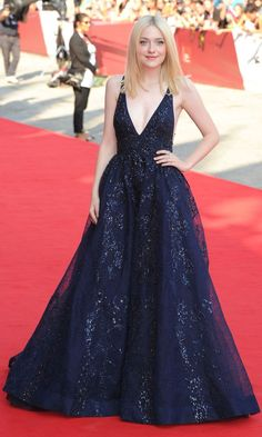 Dakota Fanning in a dazzling midnight blue beaded chiffon dress from Elie Saab's autumn couture collection.