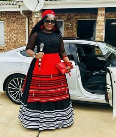 Beautiful Black Xhosa Umbhaco Dress With Red Apron, Red Beaded Cap and Beaded Stick