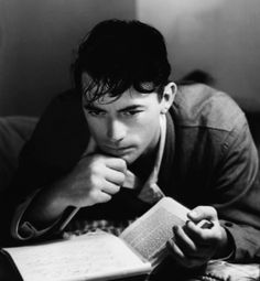 Gregory Peck with a book