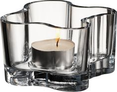 iittala Aalto Votive Candle Holder - Clear The iittala Alvar Aalto votive candle holders are inspired by Alvar Aalto's famous vase design. These lead-free glass votive candle holders have tall sides that gently wave and curve like the flicker o. Glass Votive Candle Holders, Candlestick Holders, Votive Candles, Candlesticks, Candle Sconces, Candels, Candleholders, Alvar Aalto, Pentagon Design